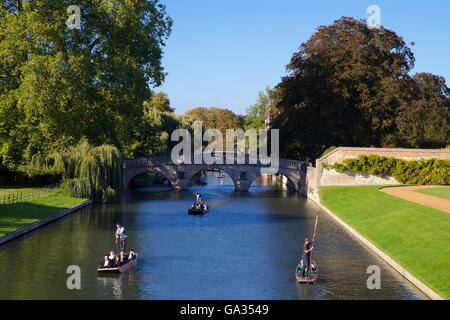Punting on the River Cam from the Backs, near King's College,  Cambridge University, Cambridgeshire, England, UK, - Stock Photo
