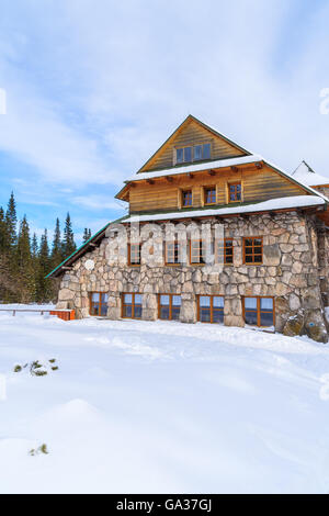 Mountain refuge Murowaniec in winter landscape of Gasienicowa valley, Tatra Mountains, Poland - Stock Photo