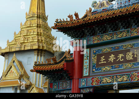 the China Gate and the Wat Traimit at the charoen krung road in the china town the city of Bangkok in Thailand in - Stock Photo