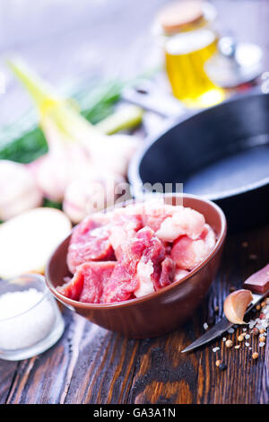 raw meat, spice and vegetables on a table - Stock Photo
