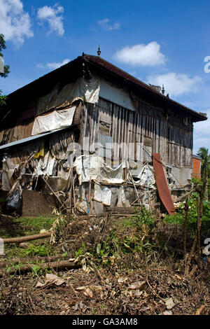 A typical wooden house on stilts is part of the community of Chork Village, Cambodia. - Stock Photo
