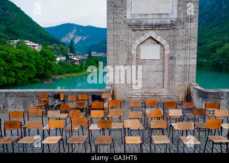 Chairs beside to Drina River and bridge. - Stock Photo