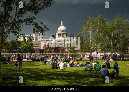 London, United Kingdom - June 25, 2016: St Pauls and a park in front of Tate Modern, moody sky seconds before a - Stock Photo