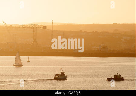 St.Mawes Ferry travelling to Falmouth Harbour bathed in beautiful soft evening sunlight at sunset - Stock Photo