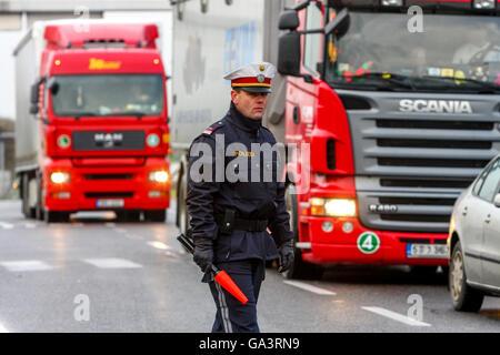 Austrian police, traffic policeman checks trucks, Austria, Europe - Stock Photo