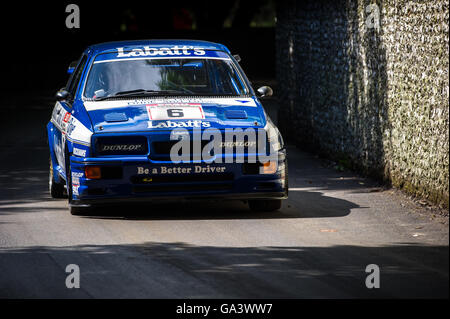 A 1989 Ford Sierra Cosworth RS500 touring car drives up the hill at the Goodwood Festival of Speed 2016 - Stock Photo