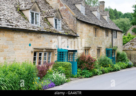 Row of cottages. Snowshill, Cotswolds, Gloucestershire, England - Stock Photo