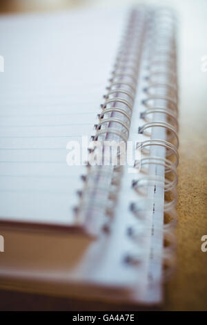 Spiral book on wooden table - Stock Photo
