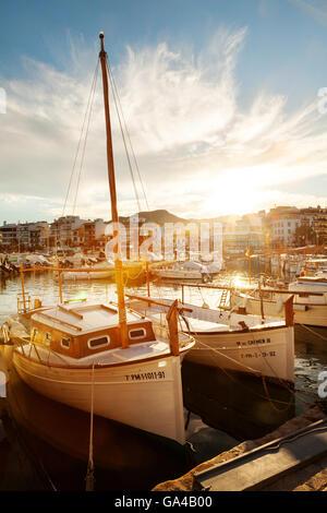 Sunset over boats in the harbour, Puerto Pollensa ( Pollenca ), Mallorca ( Majorca ), Balearic Islands, Europe - Stock Photo