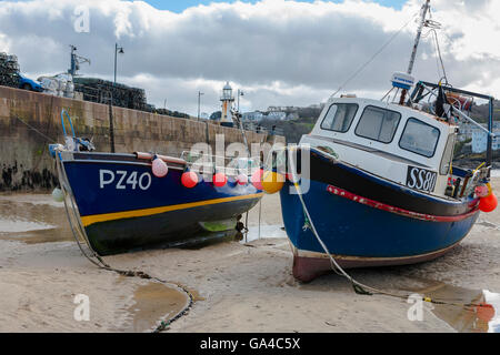 Fishing boats aground at low tide, St Ives harbour, Cornwall, UK - Stock Photo