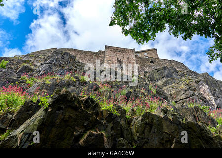 Edinburgh Castle is a historic fortress, which dominates the skyline of the city of Edinburgh, Scotland - Stock Photo