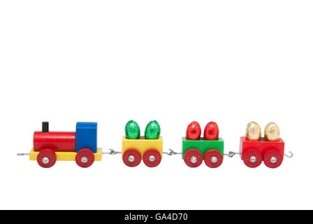 Colorful wooden model railway with Easter eggs on goods waggons, isolated - Stock Photo