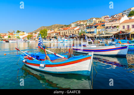 Typical colorful Greek fishing boats in Pythagorion port on Samos island, Greece - Stock Photo