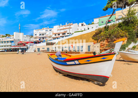Fishing boat on beach in Carvoeiro town, Portugal - Stock Photo