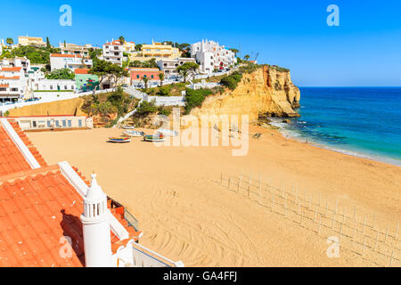 View of beach in Carvoeiro town with colorful houses on coast of Portugal - Stock Photo