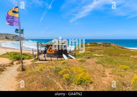 PRAIA DO AMADO BEACH, PORTUGAL - MAY 15, 2015: surfing school booth on beautiful beach in Algarve region. Surfing - Stock Photo
