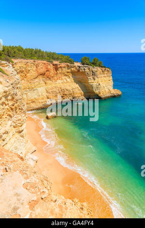 Secluded beach and cliffs on coast of Portugal near Carvoeiro town - Stock Photo