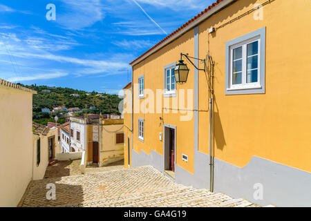 Narrow street in old town of Silves with colorful houses, Portugal - Stock Photo