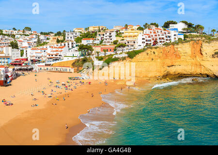 View of beach with in Carvoeiro town with colorful houses on coast of Portugal - Stock Photo
