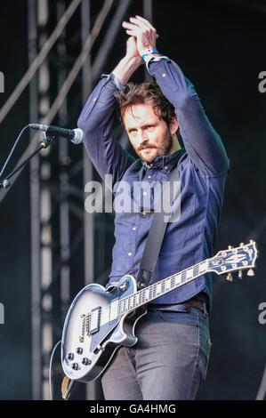 BELFAST, NORTHERN IRELAND. 25 JUN 2016 - Rhythm guitarist Ross Smithwick from the Cambridge based alternative rock - Stock Photo