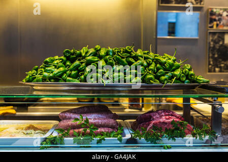 Restaurant specialized fresh vegetables and meat on the market of La Boqueria, next to Les Rambles in Barcelona, - Stock Photo