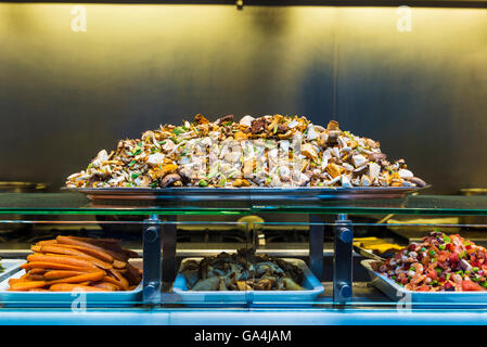 Restaurant specialized fresh vegetables and mushrooms on the market of La Boqueria, next to Les Rambles in Barcelona, - Stock Photo