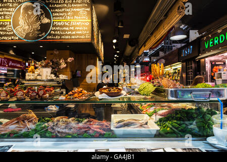Restaurant specializing in seafood and fresh fish on the market of La Boqueria, next to Les Rambles in Barcelona, - Stock Photo