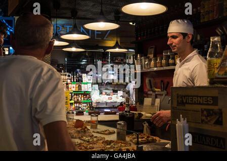 Pizza shop on the market of La Boqueria, next to Les Rambles in Barcelona, Catalonia, Spain - Stock Photo