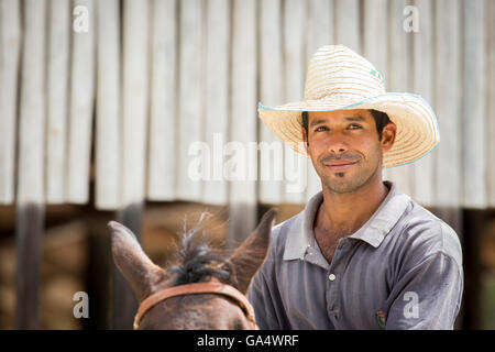 Handsome young Cowboy on horseback at Hacienda La Belen, a working ranch and popular birding area in Cuba Stock Photo