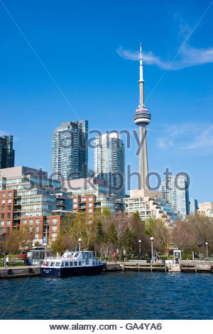 CN tower in Toronto skyline seen from Lake Ontario. The city offers boat tours which are very popular with tourists - Stock Photo