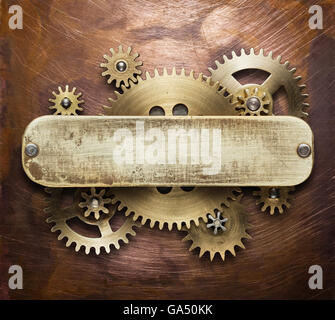 Clockwork mechanism collage on copper background made of metal gears, brass plate. - Stock Photo