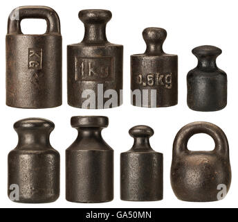 Old rusty iron scale weights isolated on white - Stock Photo