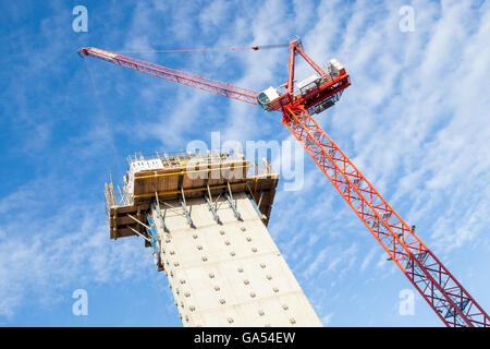 New building work. Lift shaft and tower crane on a construction site, Nottingham, England, UK - Stock Photo