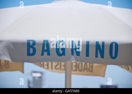 written on a parasol that indicates the presence of the lifeguard - Stock Photo
