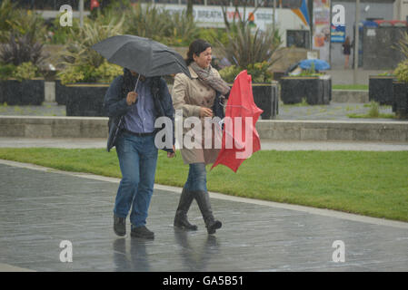 Manchester, UK. 02nd July, 2016. People, believed to be from Manchester, experiencing rainy weather on July 2nd, - Stock Photo