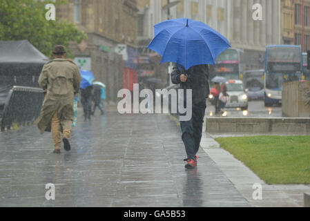 Manchester, UK. 02nd July, 2016. A person, believed to be from Manchester, experiencing rainy weather on July 2nd, - Stock Photo