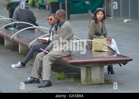 Manchester, UK. 02nd July, 2016. People, believed to be from Manchester, experiencing dry but dull weather on July - Stock Photo