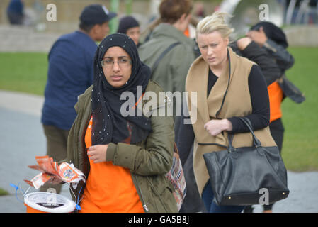 Manchester, UK. 02nd July, 2016. People, believed to be from Manchester, experiencing windy weather on July 2nd, - Stock Photo