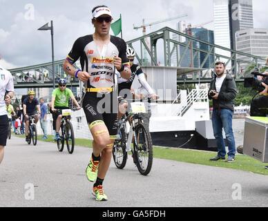 Frankfurt, Germany. 03rd July, 2016. Winner Sebastian Kienle (Germany) during the run leg of the Ironman Championship - Stock Photo