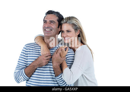 Romantic couple embracing against white background - Stock Photo