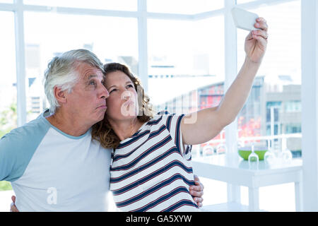 Mature couple taking selfie - Stock Photo