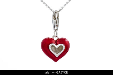 Red enamel painted heart, pendant necklace on white background - Stock Photo