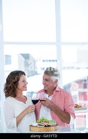 Mature couple toasting wineglasses - Stock Photo