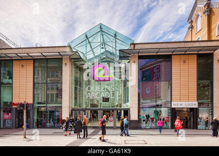 27 June 2016: Cardfiff, Wales, UK - Shoppers at the entrance to Queens Arcade, Queen Street, Cardiff, Wales. - Stock Photo