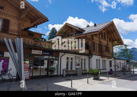 Train station of Gstaad, Switzerland, built in chalet style. - Stock Photo