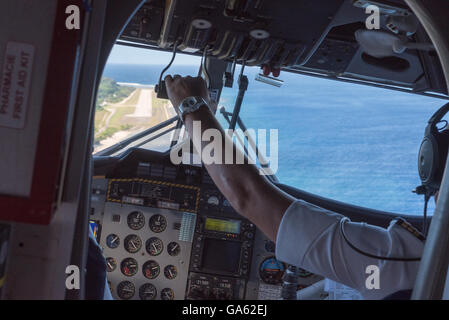 Cockpit view of a Twin Otter plane from AirCalin before landing on Futuna airport - Stock Photo