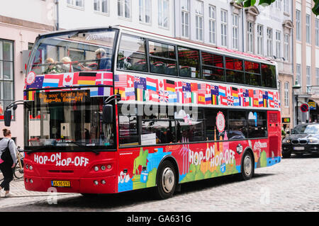 Hop-on, Hop-Off tour buss waits for passengers - Stock Photo