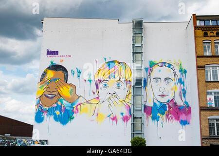Modern street art mural featuring Barack Obama, Angela Merkel and Vladimir Putin painted on building in Kreuzberg - Stock Photo