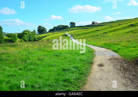 View from near the limestone pavement above Malham Cove, Yorkshire Dales National Park, near Settle, West Yorkshire - Stock Photo