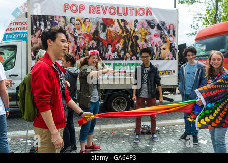 Paris, France, French Group of Teenagers talking, Playing at Gay Pride, LGBT Activism, on Street - Stock Photo
